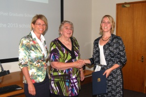 Katrina Hodgkinson MP and Vicky Cullen present Sam with her award
